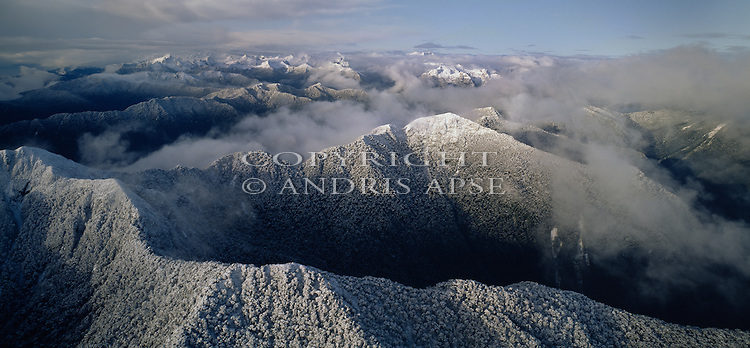 Aerial of fresh snow on mountains. Fiordland National Park. New Zealand.
