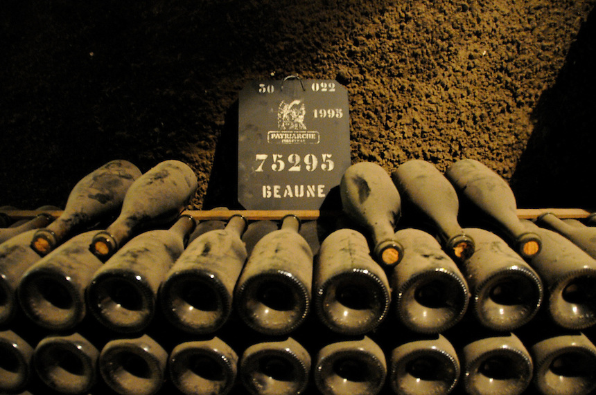 A cave holding some vintage bottles of Pere Patriarche wine in Beaune, France.