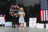 Eliana Duy, 8, FL, stands in front of the wreath that U.S. Secretary of Defense James Mattis, General John Kelly, White House Chief of Staff and Cindy McCain, wife of late Senator John McCain, lay a ceremonial wreath honoring all whose lives were lost during the Vietnam War at at the Vietnam Veterans Memorial in Washington, U.S., September 1, 2018.  <br /> Credit: Mary F. Calvert / Pool via CNP