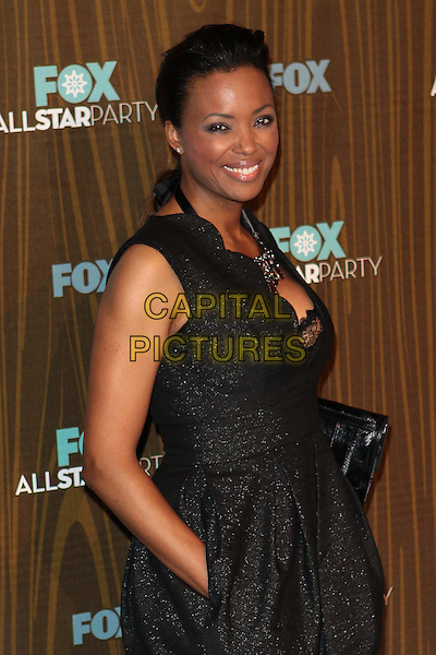 AISHA TYLER.Fox Winter All Star  Party held at Villa Sorisso, Pasadena, California, USA..January 11th, 2009.half length black sleeveless dress hand in pocket lace bra.CAP/ADM/TC.©T. Conrad/AdMedia/Capital Pictures.