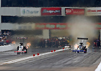 Sep 28, 2013; Madison, IL, USA; NHRA top fuel dragster driver Steve Torrence (left) races alongside Pat Dakin during qualifying for the Midwest Nationals at Gateway Motorsports Park. Mandatory Credit: Mark J. Rebilas-