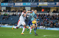 Luke O'Nien of Wycombe Wanderers battles Andre Blackman of Crawley Town during the Sky Bet League 2 match between Wycombe Wanderers and Crawley Town at Adams Park, High Wycombe, England on 25 February 2017. Photo by Andy Rowland / PRiME Media Images.
