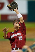 David Kindred #13 of the Alabama Crimson Tide tracks a foul pop fly against the Auburn Tigers at Riverwalk Park on March 15, 2011 in Montgomery, Alabama.  Photo by Brian Westerholt / Four Seam Images