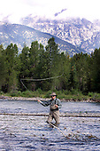 United States Vice President Dick Cheney spends the day fly fishing with his family (daughter Liz Perry Cheney, and her husband Phil Perry) along the Snake River in his home state of Wyoming on Sunday, July 08, 2001.     <br /> Mandatory Credit: David Bohrer / White House via CNP