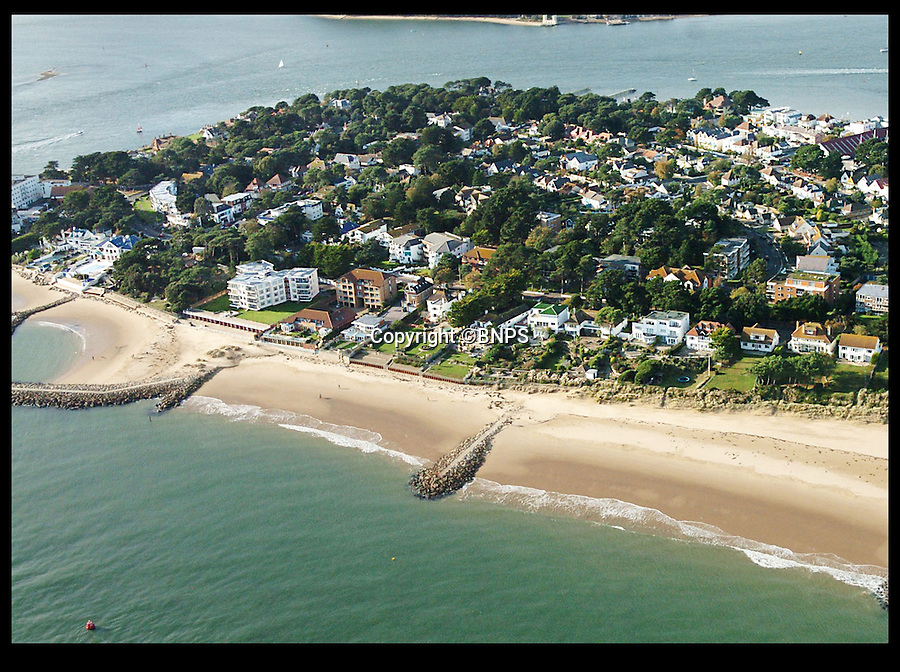 BNPS.co.uk (01202 558833)<br /> Pic: PhilYeomans/BNPS<br /> <br /> A birds-eye view of Banks Road, Sandbanks. <br /> <br /> Two luxury homes squeezed onto a plot meant for one have gone up for sale for 13 million pounds - three times the value of the former property.<br /> <br /> A three bedroom house occupied the site on Sandbanks in Poole Harbour until it was bought for 4.25 million pounds and then promptly demolished.<br /> <br /> A development company decided to eke out every square inch of the plot by splitting it in two and building a pair of four storey beachfront houses worth 6.5 million pounds each.