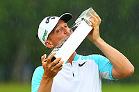 2017 Wentworth champion Alexander Noren kisses his trophy on the 18th green during the BMW PGA Golf Championship at Wentworth Golf Course, Wentworth Drive, Virginia Water, England on 28 May 2017. Photo by Steve McCarthy/PRiME Media Images.