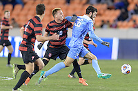Houston, TX - Friday December 9, 2016: Tucker Hume (36) of the North Carolina Tar Heels races with the ball with Corey Baird (10) of the Stanford Cardinal chasing him at the NCAA Men's Soccer Semifinals at BBVA Compass Stadium in Houston Texas.