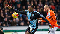 Gozie Ugwu of Wycombe Wanderers holds off Scott Cuthbert of Luton Town during the Sky Bet League 2 match between Wycombe Wanderers and Luton Town at Adams Park, High Wycombe, England on 6 February 2016. Photo by Andy Rowland.