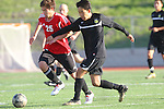 Palos Verdes, CA 02/03/12 - Charles Chae (Peninsula #9) and Chris Rieger (Palos Verdes #25) in action during the Peninsula vs Palos Verdes boys varsity soccer game.