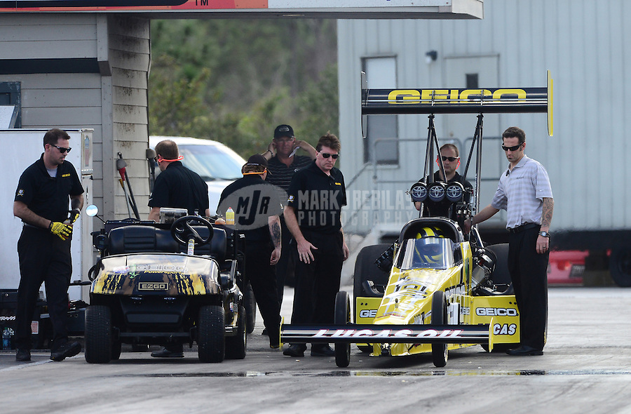 Jan. 16, 2013; Jupiter, FL, USA: Crew chief Aaron Brooks (right) stands alongside the car of NHRA top fuel dragster driver Morgan Lucas during testing at the PRO Winter Warmup at Palm Beach International Raceway.  Mandatory Credit: Mark J. Rebilas-