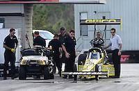 Jan. 16, 2013; Jupiter, FL, USA: Crew chief Aaron Brooks (right) stands alongside the car of NHRA top fuel dragster driver Morgan Lucas during testing at the PRO Winter Warmup at Palm Beach International Raceway.  Mandatory Credit: Mark J. Rebilas-
