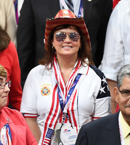 Tina Harris, a convention delegate from Florida poses for a group photo during the Monday afternoon session of the 2016 Republican National Convention held at the Quicken Loans Arena in Cleveland, Ohio on Monday, July 18, 2016.<br /> Credit: Ron Sachs / CNP/MediaPunch<br /> (RESTRICTION: NO New York or New Jersey Newspapers or newspapers within a 75 mile radius of New York City)