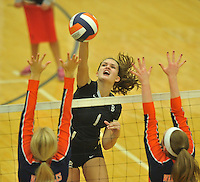 NWA Democrat-Gazette/MICHAEL WOODS &bull; @NWAMICHAELW<br /> Bentonville's Emma Palasak  tries to hit the ball past Heritage defenders during their game Tuesday September 22, 2015 at Heritage High School.