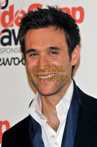 RIK MAKAREM .Attending the Inside Soap Awards 2010 held at Shaka Zulu, Camden, London, England, UK, September 27th 2010. .portrait headshot white black shirt blue  smiling stubble facial hair .CAP/PL.©Phil Loftus/Capital Pictures.