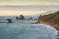 Rock formations and sunset on coastline near Greymouth, West Coast, Buller Region, New Zealand