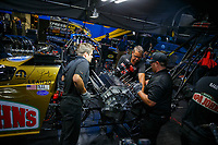 Jul 21, 2017; Morrison, CO, USA; Crew members for NHRA top fuel driver Leah Pritchett perform an engine change in the pits during qualifying for the Mile High Nationals at Bandimere Speedway. Mandatory Credit: Mark J. Rebilas-USA TODAY Sports