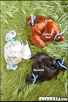 BNPS.co.uk (01202 558833)<br /> Pic: Cushzilla/BNPS<br /> <br /> ***Please use full byline***<br /> <br /> Pigtails and bows wig.<br /> <br /> A barking-mad designer has launched a range of wigs that turn pets into pop princesses including Katy Perry, Lady Gaga, Britney Spears and even Dolly Parton.<br /> <br /> Dogs and cats can also be dressed up as dragons, pilots, wizards or Prince Charming thanks to Leah Workman's wacky creations.<br /> <br /> The 40-year-old from Los Angeles spotted the trend of dressing up pets while studying in Japan - and later teamed up with husband Hiroshi Hibino to launch company Cushzilla.<br /> <br /> The pair instantly set tails wagging around the internet with their bonkers brand of pet fashion, which also features Sharon Osbourne and Sid Vicious wigs and cow and tiger costumes.<br /> <br /> Leah imports the high quality handmade wigs while costumes come from famous Japanese pet clothing designer Takako Iwasa.<br /> <br /> She says the most popular wig is the Lady Gaga, while the pilot's outfit tops the popularity charts in the costume department.<br /> <br /> Her own cats Jitters and Justus model many of the products on the company's website.