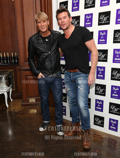 Gary Cockerill and Phil Tuner arriving for the Style for Stroke Party, 5 Cavendish Square, London. 02/10/2012 Picture by: Henry Harris  / Featureflash
