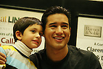 Bold and The Beautiful's Mario Lopez and fan with a new book Mud Tacos or Tacos de Lodo on October 16, 2009 at Lincoln Square Barnes & Noble, New York City, New York. (Photos by Sue Coflin/Max Photos)