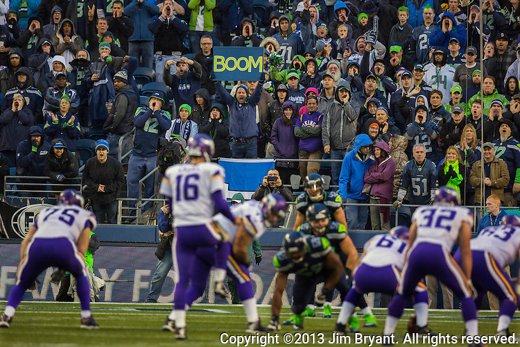 Seattle Seahawks fans cheer against the Minnesota Vikings in the fourth quarter at CenturyLink Field in Seattle, Washington on  November 17, 2013.  The Seahawks beat the Vikings 41-20.  ©2013.  Jim Bryant. All Rights Reserved.