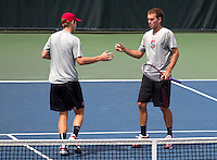 STANFORD, CA -- April 11, 2014: Jamin Ball  and John Morrissey, during Stanford vs Washington on Friday afternoon at Taube Family Tennis Stadium.