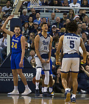 Nevada forward Trey Porter (15) reacts after getting fouled on a dunk play against South Dakota State in the second half of an NCAA college basketball game in Reno, Nev., Saturday, Dec. 15, 2018. (AP Photo/Tom R. Smedes)