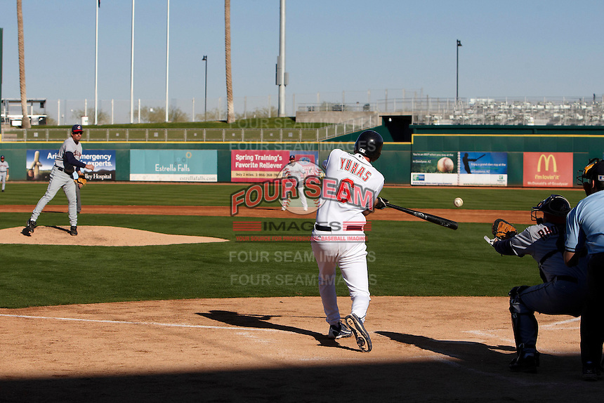 Camper gets a hit off former major league pitcher Dave Burba during the campers vs pros game at the Cleveland Indians Fantasy Camp at Goodyear Stadium on January 19, 2012 in Goodyear, Arizona.  (Mike Janes/Four Seam Images)