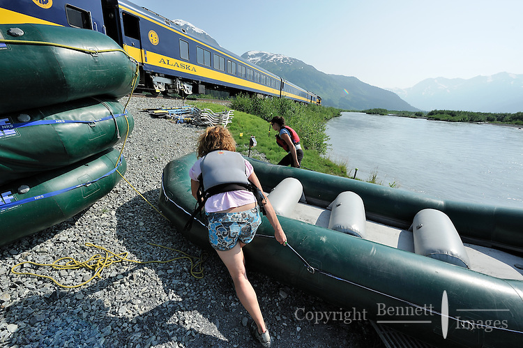 Guides haul a raft out of the water after taking passengers down the Place River. The Alaska Railroad's Spencer Glacier Whistlestop train gives visitors access to hiking, camping and stunning views.