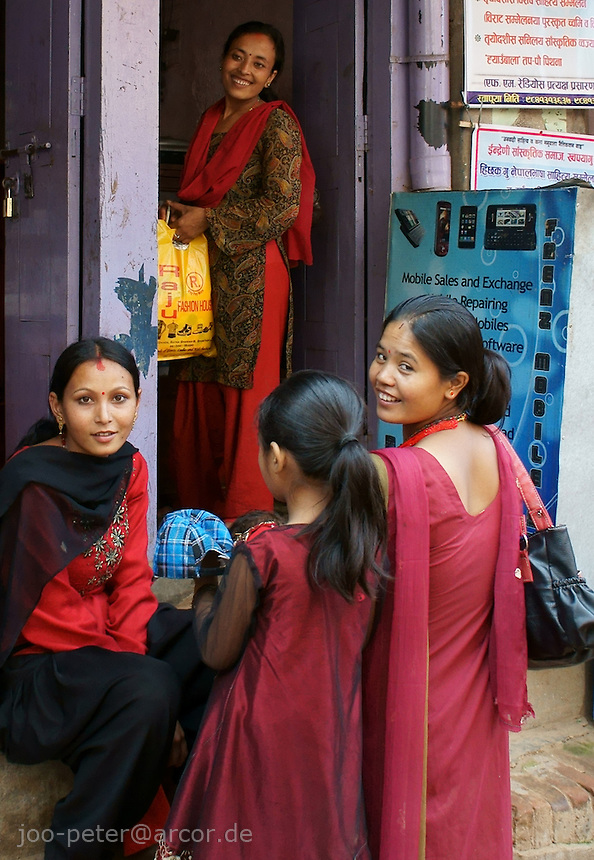 women chatting in the streets of Bhaktapur,Nepal during  days of dashein festival