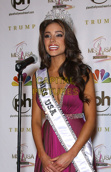 Olivia Culpo.press conference to introduce the 2012 Miss USA (formerly Miss Rhode Island) at Planet Hollywood Resort and Casino, Las Vegas, Nevada, USA..3rd June 2012.half length pink dress crown sash microphone cleavage .CAP/ADM/MJT.© MJT/AdMedia/Capital Pictures.