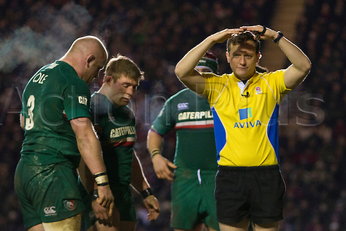 28.12.2013 Leicester, England. Referee Matt CARLEY indicates a reset scrum during the Aviva Premiership game between Leicester Tigers and Sale Sharks from Welford Road.