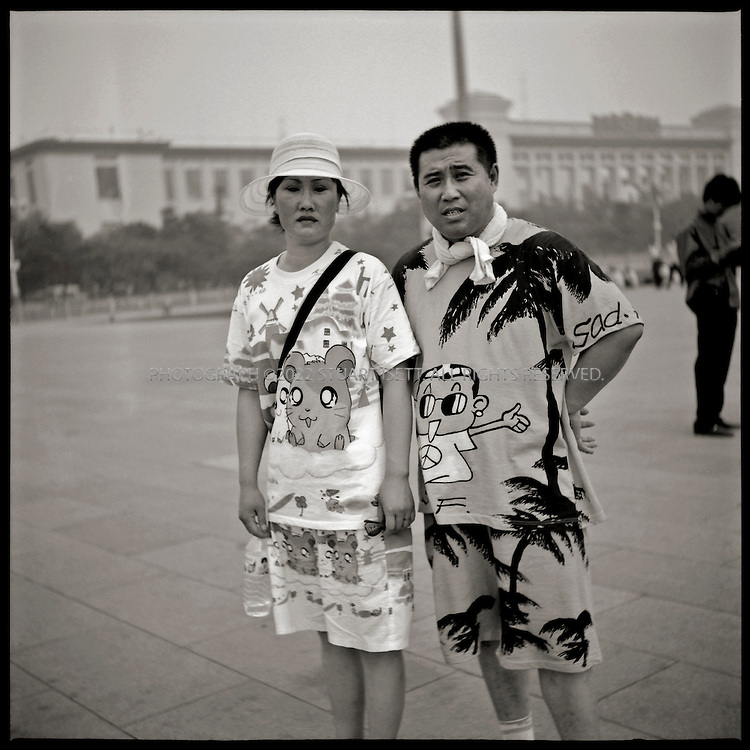6/26/2005--Beijing, China..Shi Chang Po (right) and his wife, Yuan Xiaoyan from Jiling Province on holiday in Beijing at Tiananmen Square....Photograph By Stuart Isett.All photographs ©2005 Stuart Isett.All rights reserved.
