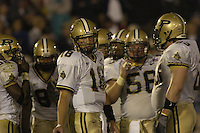 09 October 2004:  Kyle Orton, Purdue QB, in the huddle with the Purdue offense.<br />