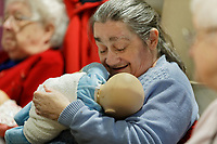 Pictured: Alison Penny. Thursday 12 December 2019<br /> Re: Realistic looking baby dolls used for therapy at the Oaklands Day Centre in Rhymney near Tredegar south Wales, UK.