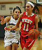Samantha Hinke #11 of Half Hollow Hills West, right, gets pressured by Mia Triolo #12 of Harborfields during the Russ Tietjen Invitational final at Harborfields High School on Friday, Dec. 1, 2017. Hinke scored 23 points to lead Hills West to a 61-54 win.