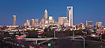 An updated Charlotte NC skyline photo after the sun has gone down. Charlotte NC makes a great skyline photo, and a great way to represent the Queen City. The skyline has changed and grown incredibly over the last few years, so if youre using a blurry, or outdated Charlotte skyline photo, consider what that says, and upgrade to a high quality skyline photograph. You will not find many photos taken from this angle with the streaming tailights in the foreground, as many photographers are forced to take this shot from street level, where there are many obstructions, and this foreground is not visible.