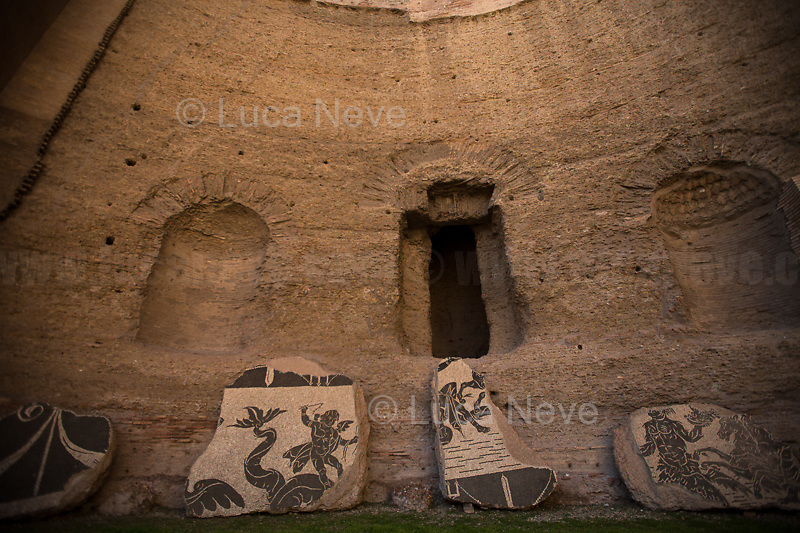 "Rome, 03/03/2019. Visiting and documenting le Terme Di Caracalla (the Bath Of Caracalla, Thermae Antonianae). «[…] The Thermae Antonianae, one of the largest and best preserved examples of an ancient spa complex, was constructed under the auspices of the Emperor Caracalla in the southern part of the city. The building was finished in 216 A.D. and exhibits the rectangular plan typical of Imperial spa centres. The spa itself was not simply a place for bathing, sport and health, it was also a place of study and for relaxing. […] Around the centre of the structure the various parts of the spa are found in sequential order: the ""Calidarium"", the ""Tepidarium"", the ""Frigidarium"" and the ""Natatio"". There are also other zones and areas to be found around the two gymnasiums. […] Written manuscripts refer to enormous marble columns, flooring made of coloured marble, mosaics of glass and marble on the walls, painted stuccos and hundreds of statues located in niches and placed centrally in the rooms themselves. The water system was made possible by the construction of a special duct from the main aqueduct called the Aqua Antoniana […]» (1.).<br />