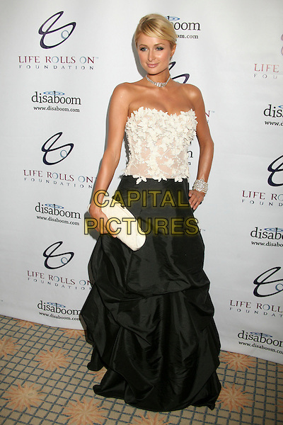 "PARIS HILTON.4th Annual ""Night By the Ocean"" Gala Benefitting the Life Rolls On Foundation at the Beverly Hills Hotel, Beverly Hills, California, USA..July 22nd, 2007.full length black skirt dress white strapless clutch purse bracelet pearl hand on hip.CAP/ADM/BP.©Byron Purvis/AdMedia/Capital Pictures"