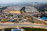 Train systems and residential apartment blocks in the city of Nanning. /Felix Features