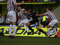 Jim Goodwin goes in on Anthony Watt watched by David Barron in the St Mirren v Celtic Clydesdale Bank Scottish Premier League match played at St Mirren Park, Paisley on 20.10.12.