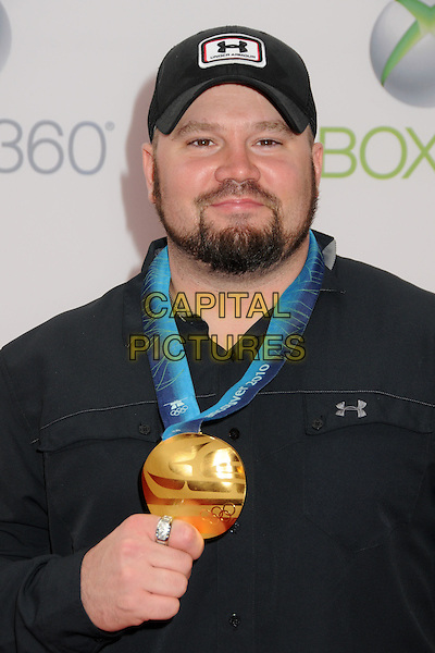 "STEVE HOLCOMB.Xbox 360's ""Project Natal"" Premiere Party held at USC's Galen Center, Los Angeles, California, USA..June 13th, 2010.headshot portrait black  necklace blue ribbon medal baseball cap hat beard facial hair.CAP/ADM/BP.©Byron Purvis/AdMedia/Capital Pictures."