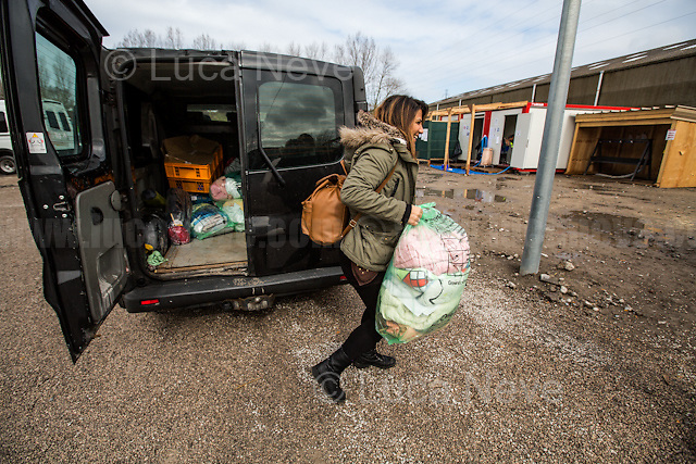 """Blankets.<br /> <br /> Dunkirk Camp.<br /> <br /> Under the Sky of Calais & Dunkirk. Two Camps, Two Sides of the Same Coin: Not 'migrants', Not 'refugees', just Humans.<br /> <br /> France, 24-30/03/2016. Documenting (and following) Zekra and her experience in the two French camps at the gate of the United Kingdom: Calais' """"Jungle"""" and Dunkirk's """"Grande-Synthe"""". Zekra lives in London but she is originally from Basra in Iraq. Zekra and her family had to flee Kuwait - where they moved for working reason - due to the """"Gulf War"""", and to the Western Countries' will to """"export Democracy in Iraq"""". Zekra is a self-motivated volunteer and founder of """"Happy Ravers"""", a group of people (not a NGO or a charity) linked to each other because of their love for rave parties but also men and women who meet up every week to help homeless people and other people in need in Central London. (Here there are some of the stories I covered about Zekra and """"Happy Ravers"""": http://bit.ly/1XVj1Cg & http://bit.ly/24kcGQz & http://bit.ly/1TY0dPO). Zekra worked as an English teacher in the adult school at Dunkirk's """"Grande-Synthe"""" camp and as a cultural mediator and Arabic translator for two medic teams in Calais' """"Jungle"""". Please read her story at the beginning of this reportage."""