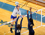 BROOKINGS, SD - OCTOBER 28:  Nazya Thies #6 from South Dakota State tries for a kill past Megan Doran #14 and Brianna Greenlee #12 from Oral Roberts Friday night at Frost Arena in Brookings. (Photo by Dave Eggen/Inertia)