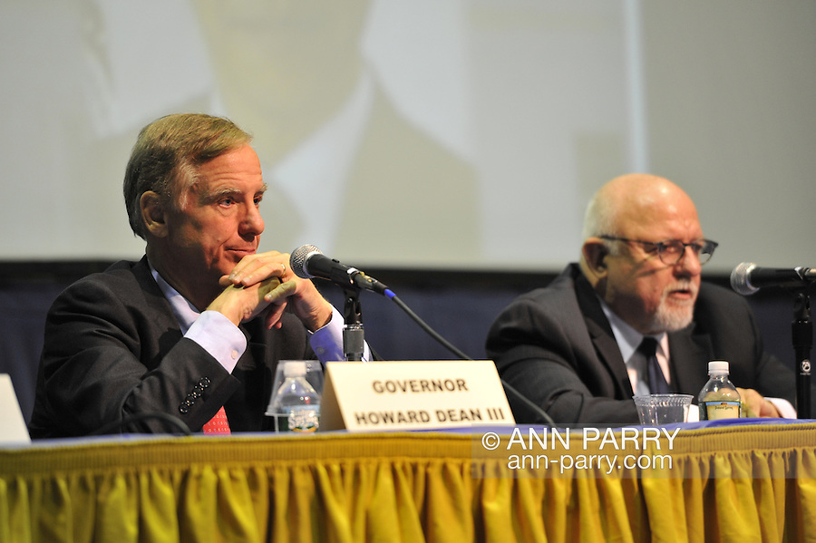 "Governor Howard B. Dean III (left), Edward J. Rollins (right) are panelists at ""Change in the White House? Comparing the George W. Bush and Barack Obama Presidencies"" on Thursday, April 19, 2012, at Hofstra University, Hempstead, New York, USA. Hofstra's event was part of ""Debate 2012: Pride, Politics and Policy"" which leads up to the Presidential Debate Hofstra is hosting on October 15, 2012. Governor Howard B. Dean III, is a former Democratic National Committee Chairman, presidential candidate, six term Governor of Vermont, and physician. Edward J. Rollins managed President Ronald Reagan's 49 state landslide reelection campaign in 1984, and had major managerial roles in nine other Presidential campaigns. Lord Stewart Wood, a British academic and Labour life peer in the House of Lords, served as Senior Policy Advisor to Prime Minister Brown and campaign manager for the successful campaign of Ed Milliband to Labour Party Leader."