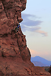 Rock climber on Owl Tower at sunset, Garden of Eden Area, Arches National Park, Moab, Utah. .  John offers private photo tours in Arches National Park and throughout Utah and Colorado. Year-round.