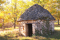 A typical country hut with walls and roof of stone, called Borie, no mortar is used when building the hut, the stones are just piles one atop the other Truffiere de la Bergerie (Truffière) truffles farm Ste Foy de Longas Dordogne France