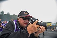 Oct 1, 2016; Mohnton, PA, USA; NHRA photographer Richard Shute during qualifying for the Dodge Nationals at Maple Grove Raceway. Mandatory Credit: Mark J. Rebilas-USA TODAY Sports