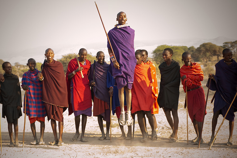 Note the boys in black clothing. They are still in the process of healing after circumcision and will soon become warriors taking over from senior warriors who will themselves get married and join the ranks of elders.  Maasai boys wear plain robes or togas until they are initiated.