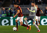 Calcio, andata degli ottavi di finale di Champions League: Roma vs Real Madrid. Roma, stadio Olimpico, 17 febbraio 2016.<br /> Roma's Diego Perotti, left, is chased by Sergio Ramos during the first leg round of 16 Champions League football match between Roma and Real Madrid, at Rome's Olympic stadium, 17 February 2016.<br /> UPDATE IMAGES PRESS/Riccardo De Luca