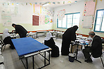 People get treated by doctors from the 'Physicians for Human Rights' organization, in a school building in the village of Takuah, West Bank. The organization, comprised of Israeli, Palestinian and international physicians, arrived to the West Bank village to give medical treatment for locals, who are otherwise have difficulties to cross into Israel to get such treatment in advanced hospitals.